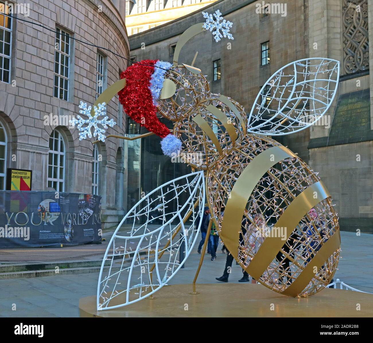 Gold bee,Christmas decorations,outside Manchester Central Library,St Peter's Square, Manchester M2 5PD Stock Photo
