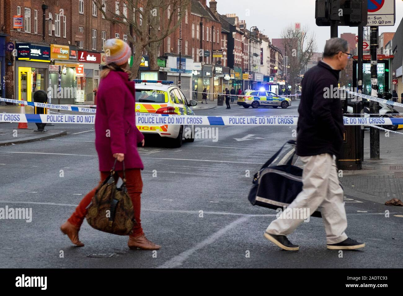 Turnpike Lane, North London, UK. 5th Dec, 2019. Police seal off the scene of a shooting outside Turnpike Lane in north London. A teenager was killed at around 11pm on 4th December (c) Credit: Paul Swinney/Alamy Live News Stock Photo