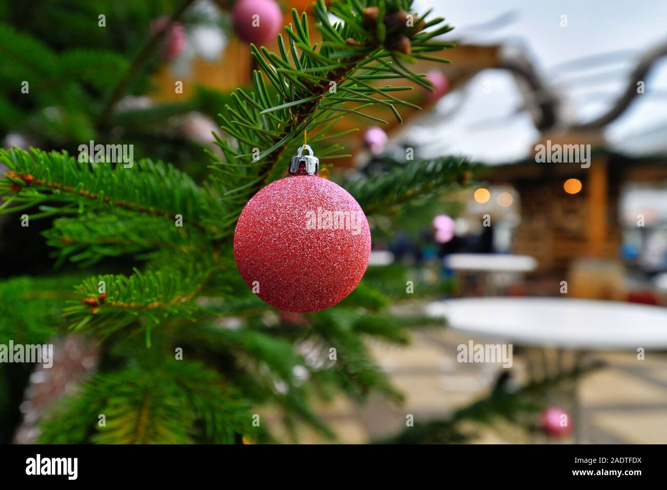 Sparkling Bright Pink Christmas Tree Ornament Bauble With Sales Booth In Blurry Background On Traditional Christmas Market Stock Photo Alamy