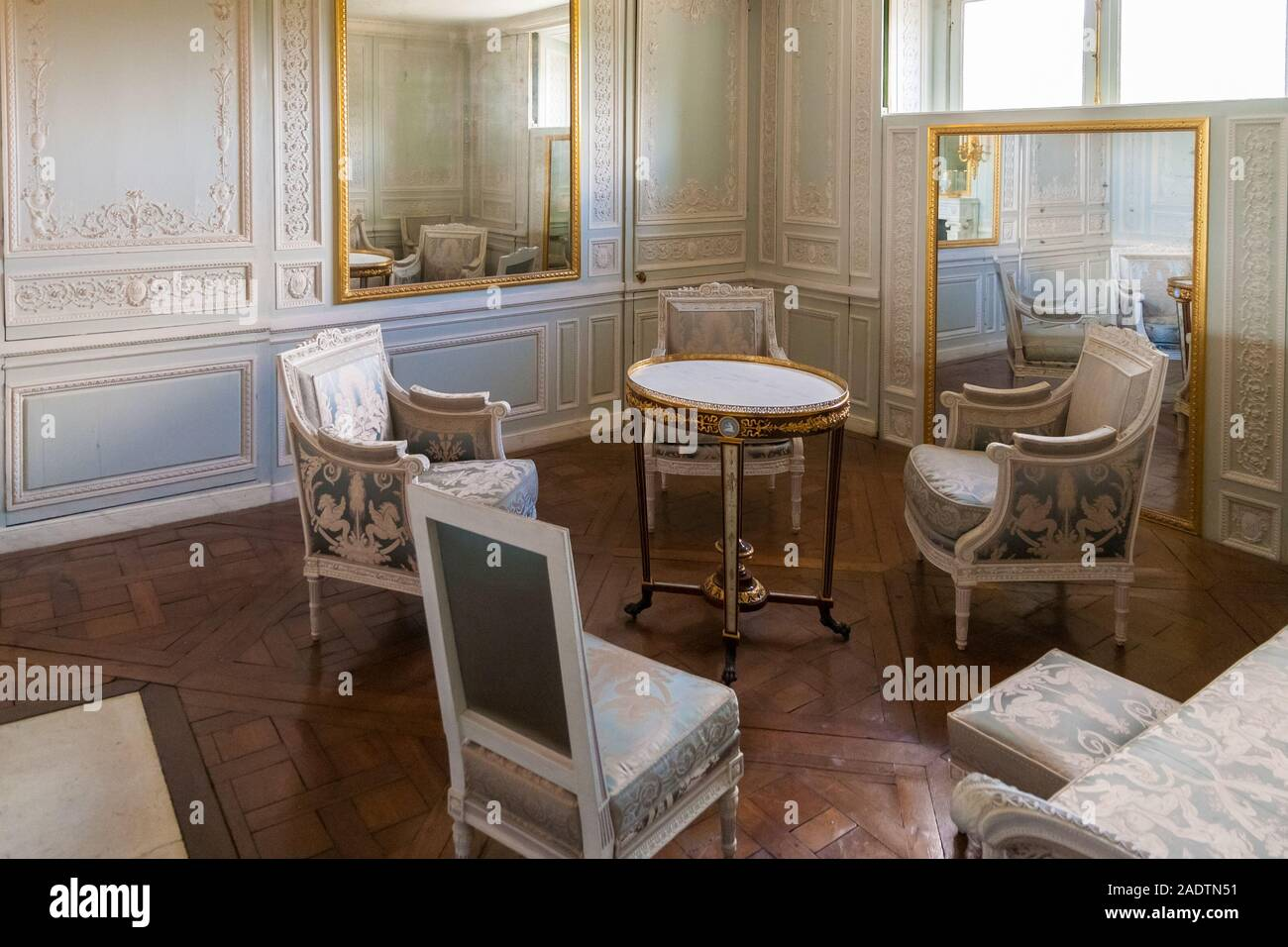 "Close view of the famous boudoir or ""moving mirror room"" in the Petit Trianon Palace in Versailles. The room has moving wall panels that could slide... Stock Photo"