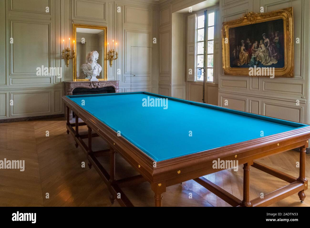Perfect view of the billiard room on the ground floor in the Petit Trianon Palace in Versailles. Over the fireplace is a bust of Marie-Antoinette by... Stock Photo