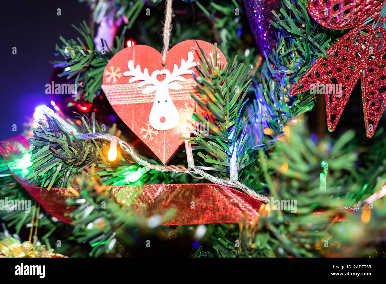 Christmas Hanging Decorations On Fir Tree Decorated Christmas Tree Fir Branch With Christmas Decorations Surrounded By Lights And Garlands Stock Photo Alamy