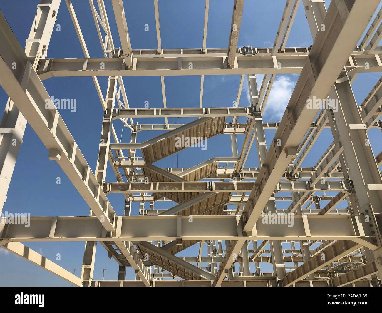 Metal frame of prefabricated multi-storey building. Metal pillars, beams, diagonal bracings and ladders Stock Photo