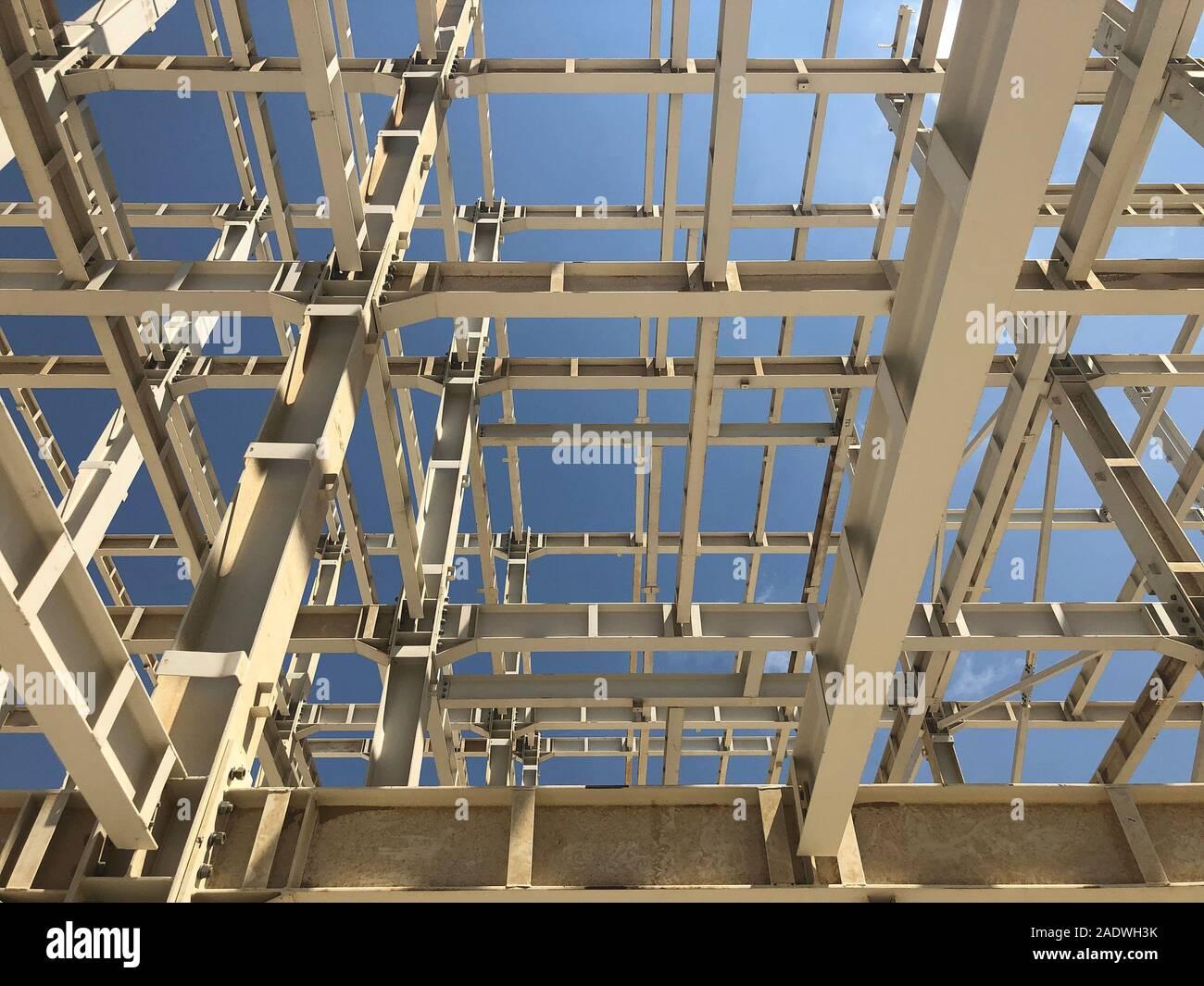 Metal frame of prefabricated multi-storey building. Metal pillars, beams and diagonal bracings Stock Photo