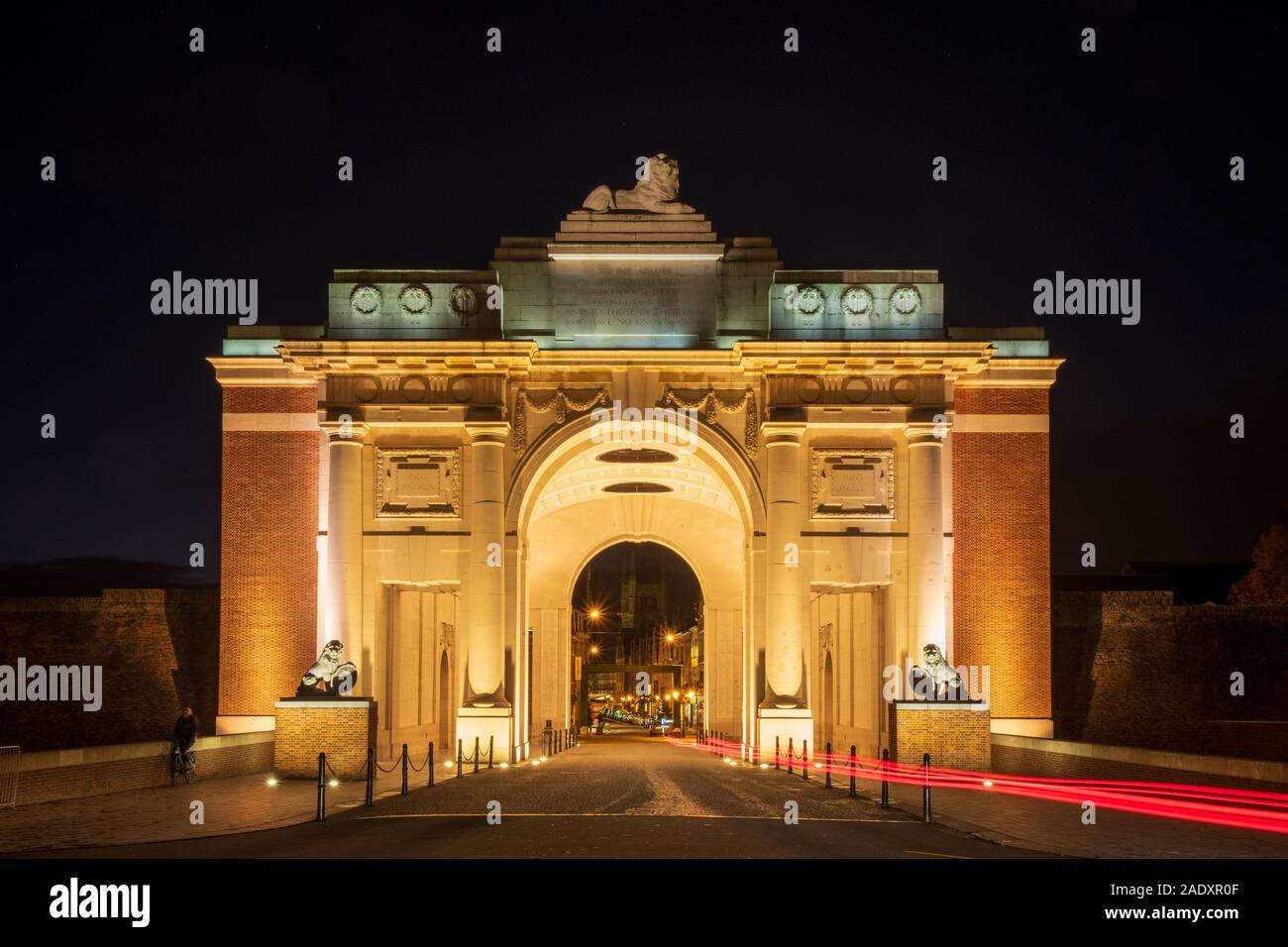 The Menin Gate Memorial to the Missing illuminated at night, Ypres Stock Photo