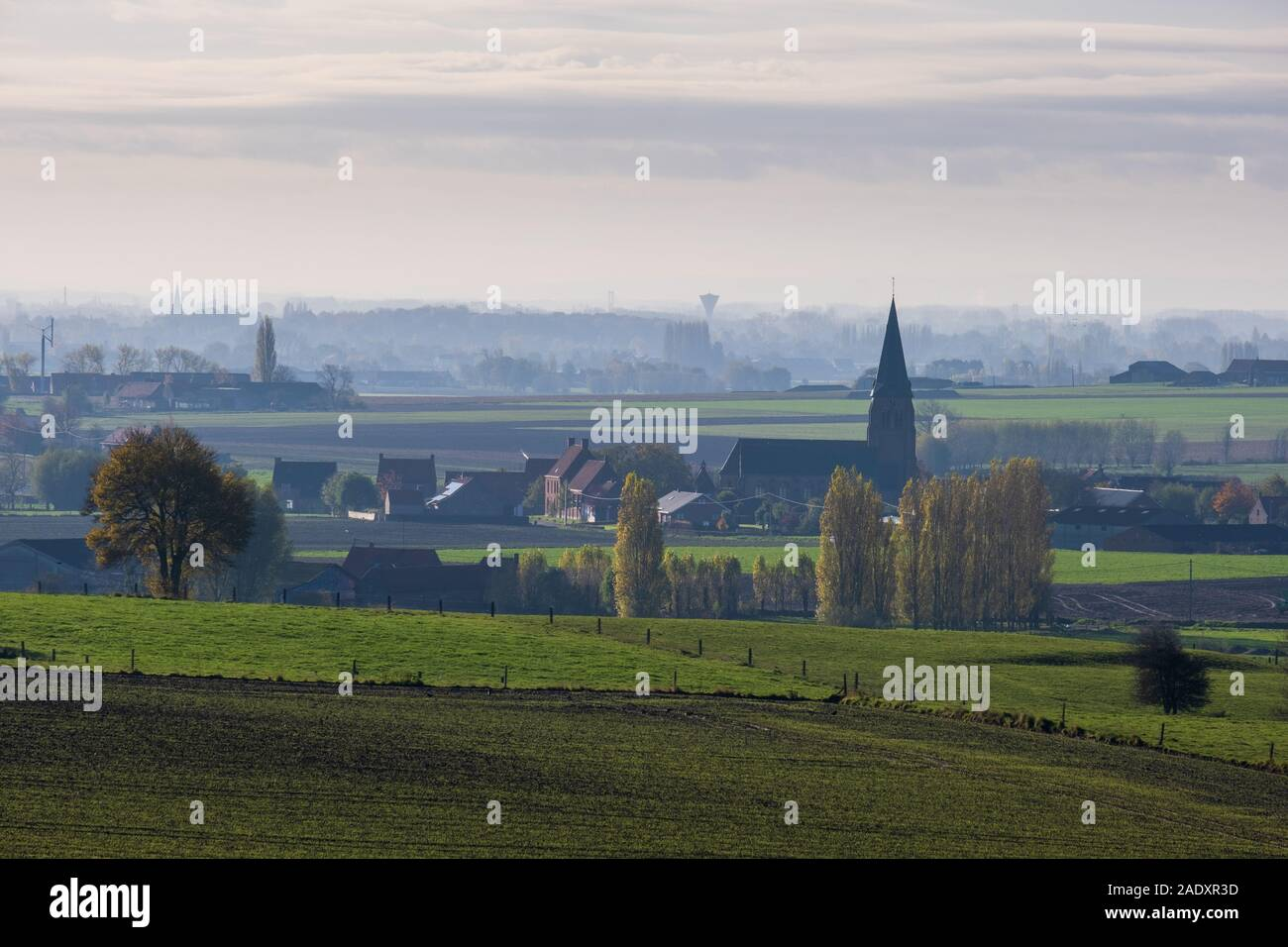 View over former Ypres Salient First World War Battlefield, with church of Wulvergem Stock Photo