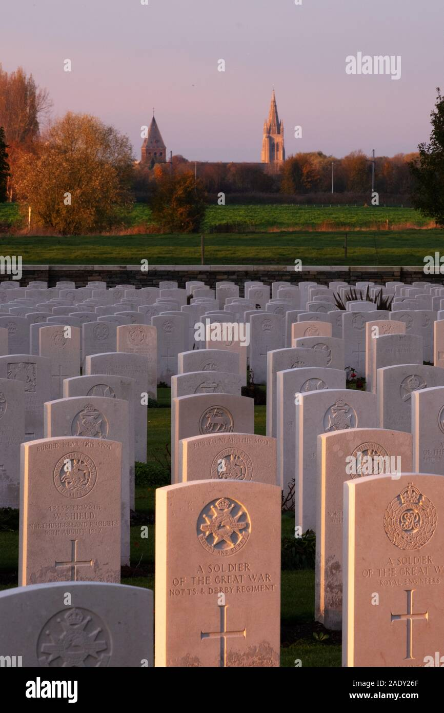 British war graves in Ypres Salient with skyline of Ypres in background Stock Photo