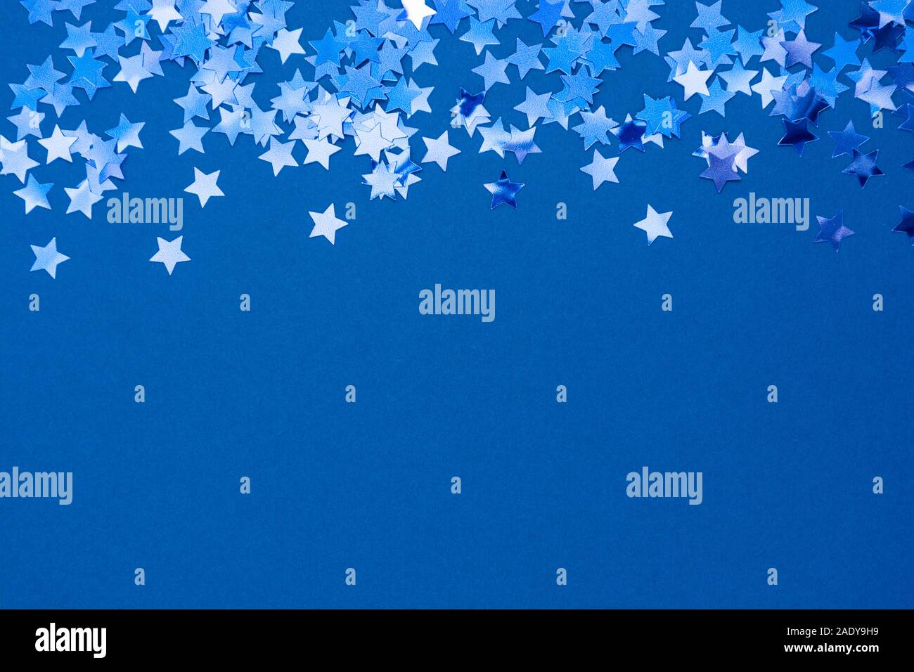blue christmas background stars light high resolution stock photography and images alamy https www alamy com blue abstract christmas background or texture with stars confetti on blue background space for text image335587765 html