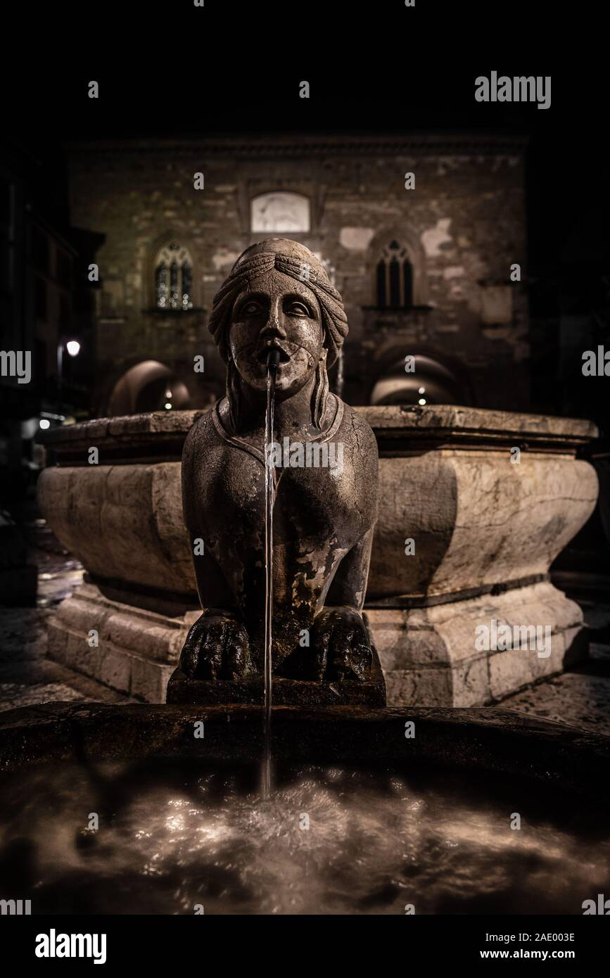 Night image of the fountain detail of Piazza Vecchia, the Sphinx of the Contarini fountain in the center of the square in Bergamo Alta, historic city Stock Photo