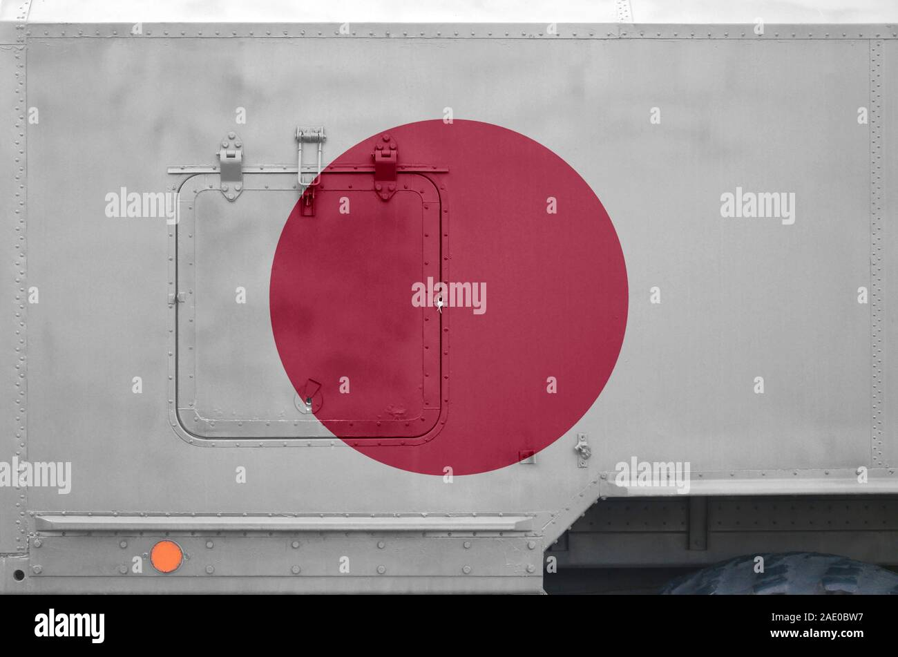 Japan flag depicted on side part of military armored truck close up. Army forces vehicle conceptual background Stock Photo