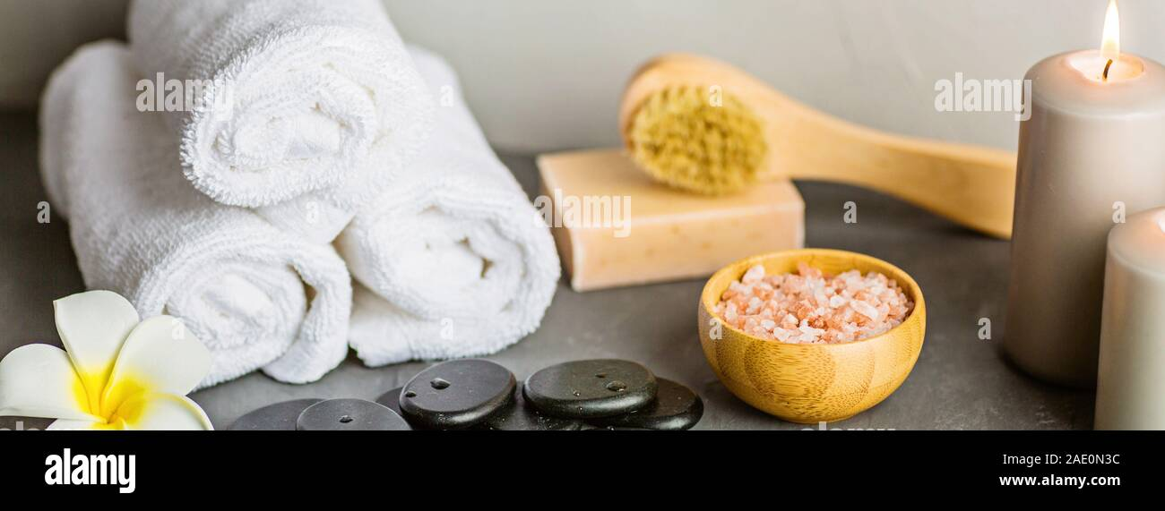 hot spa stones set for massage treatment and bamboo on concrete background. Elegant and luxury spa. mockup, template. Health and beauty care concept Stock Photo