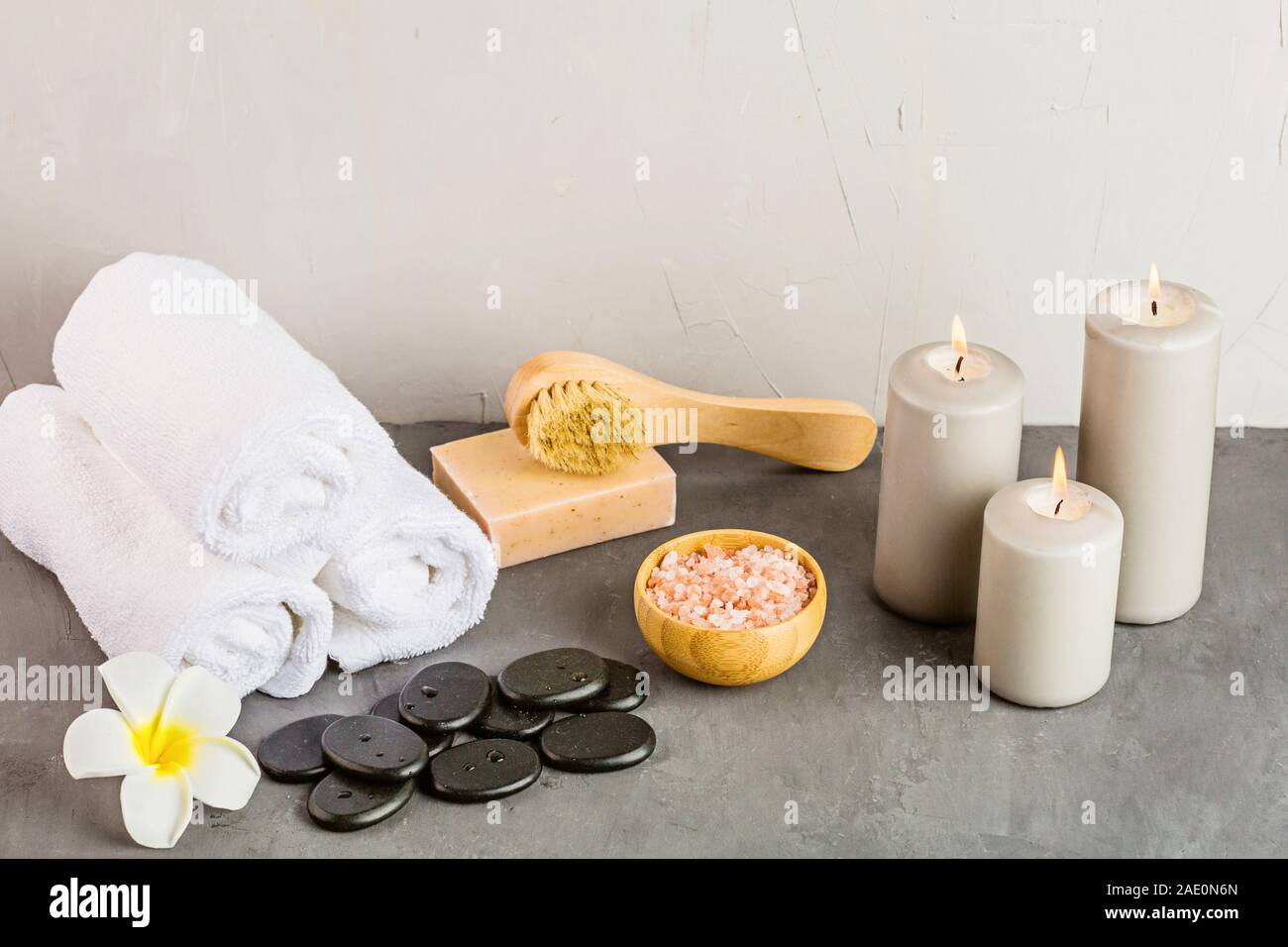 hot spa stones set for massage treatment and bamboo on concrete background with copy space. Elegant and luxury spa. mockup, template. Health and beaut Stock Photo