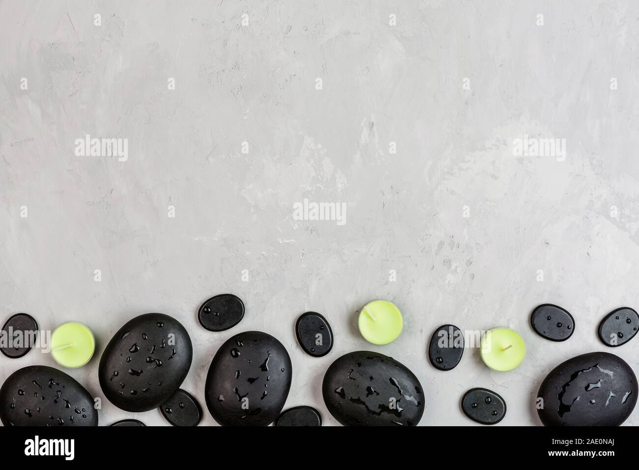Top view of hot spa stones set for massage treatment and bamboo on concrete background with copy space. Elegant and luxury spa. Flat lay, overhead, mo Stock Photo