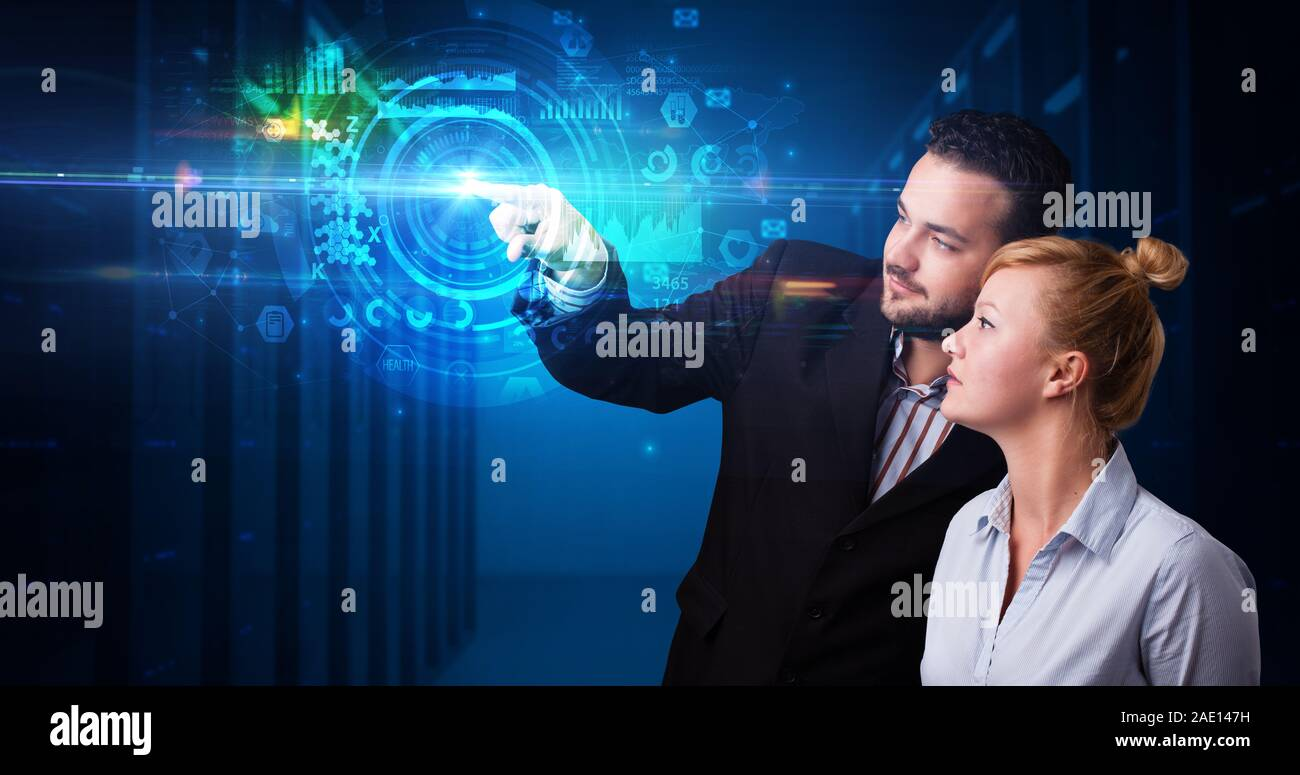 Man and woman touching hologram screen displaying medical symbols and charts Stock Photo