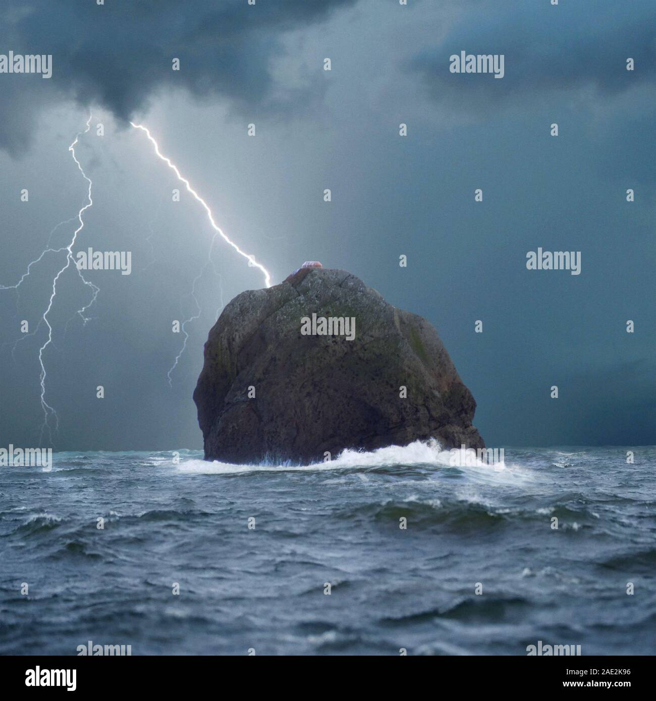 Rockall during a lightning storm. Rockall Island is one of the few pinnacles of the Helen's Reef, the surrounding elevated seabed is called the Rockal Stock Photo