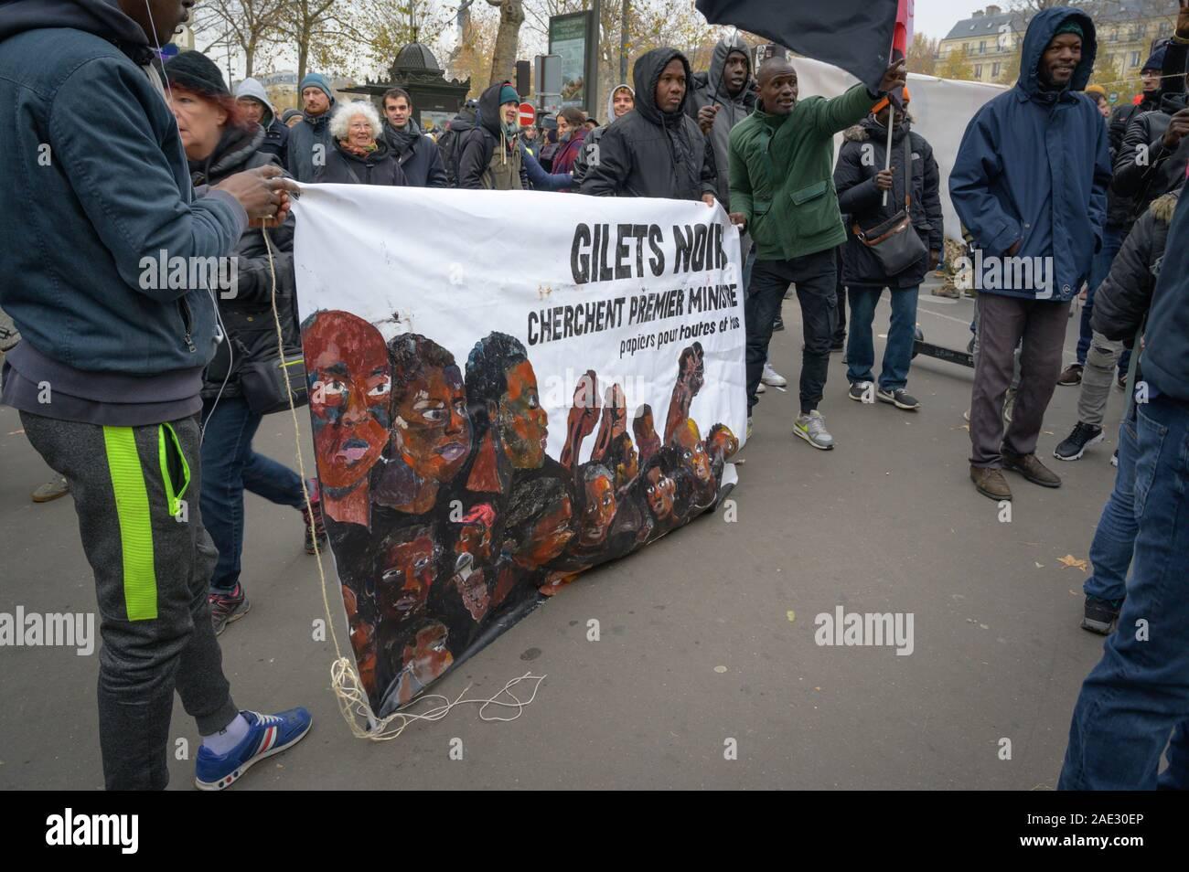 "PARIS, FRANCE DECEMBER 05 2019 : a ""Gilets Noirs"" (Black Vests) protesters during a ""Gilets Jaunes"" (Yellow Vests) protest. Stock Photo"