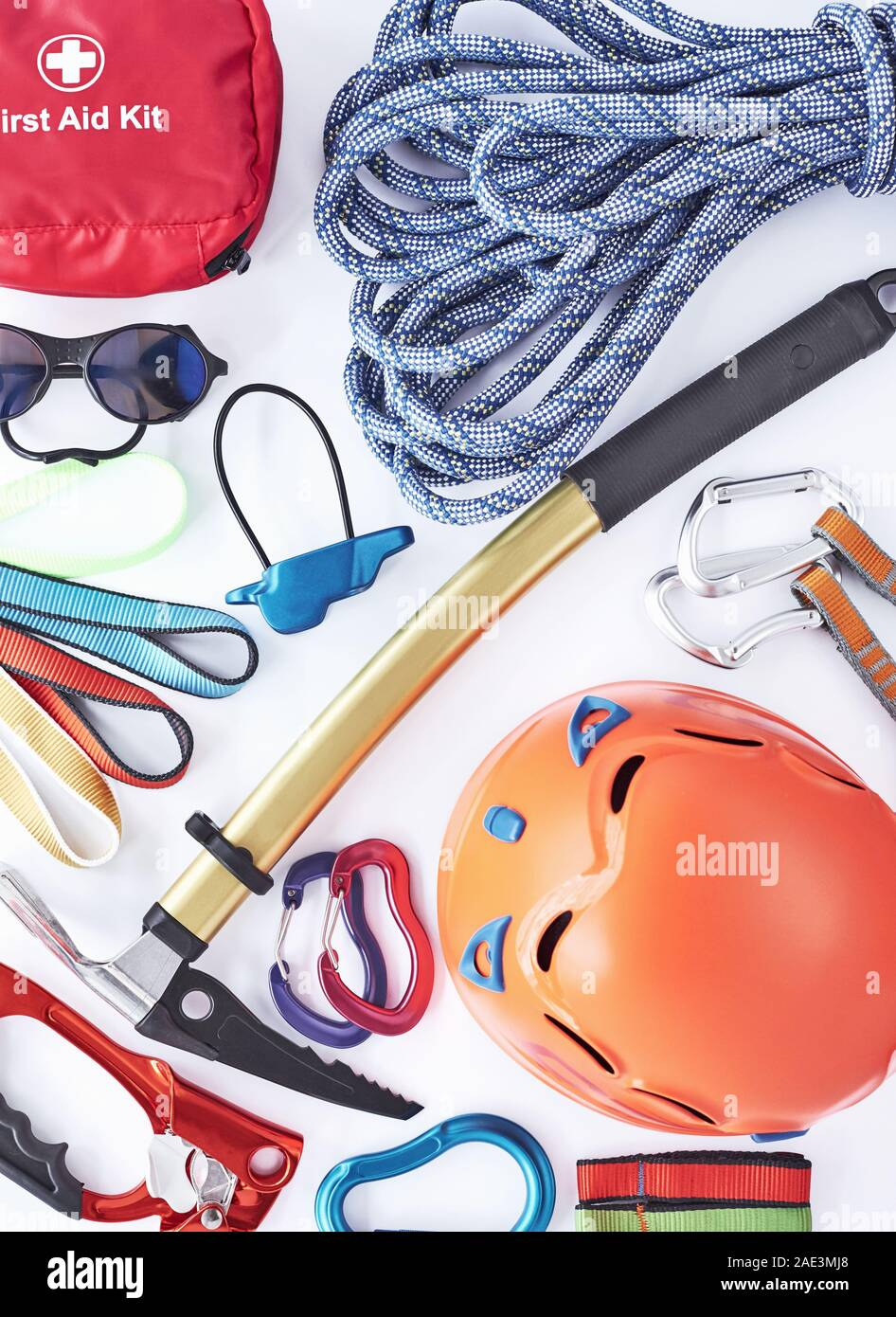 Beautiful new materials. Top view. Climbing equipment for the safeness lying on the white table. Conception of extreme sports Stock Photo