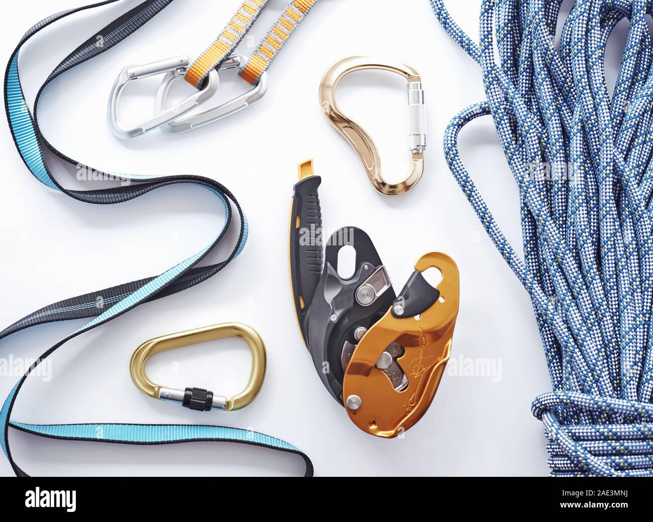 Store shelf. Top view. Climbing equipment for the safeness lying on the white table. Conception of extreme sports Stock Photo