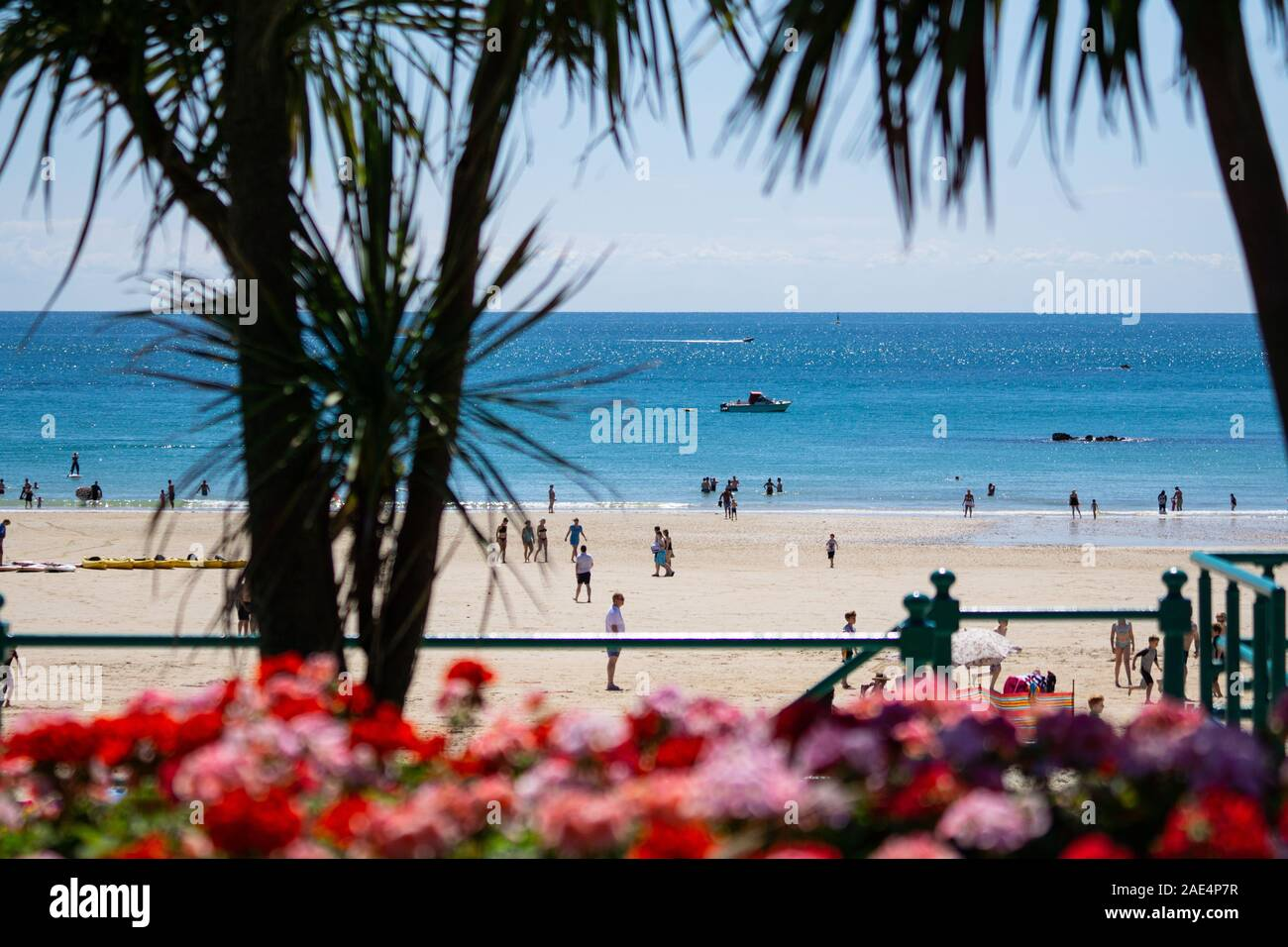 People enjoying the beach on a summers day at St.Brelades Bay,Jersey,Channel Islands Stock Photo