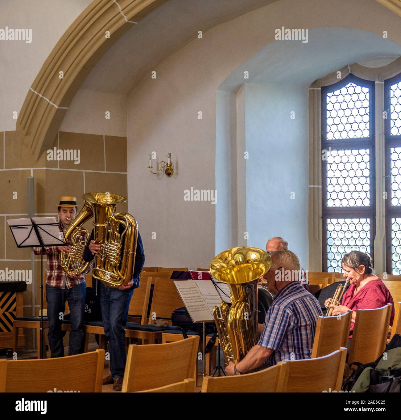 Brass band playing in Castle Hartenfels chapel the first Protestant church in the world, Altstadt Torgau Saxony Germany. Stock Photo