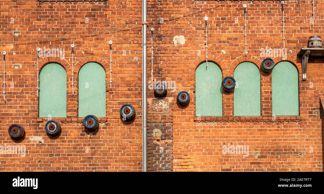 Abstract patterns on red brick wall of former factory redeveloped as hotel brewery restaurant and concert venue in Wittenberge Brandenburg Germany. Stock Photo