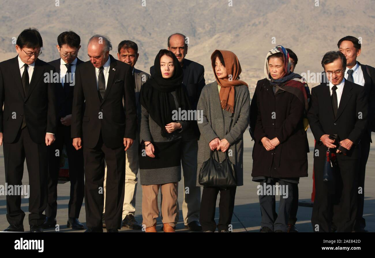 Kabul, Afghanistan. 7th Dec, 2019. The wife and daughter of slain Japanese aid worker Tetsu Nakamura attend a repatriation ceremony of his remains at Hamid Karzia International Airport in Kabul, Afghanistan, Dec. 7, 2019 . Credit: Rahmatullah Alizadah/Xinhua/Alamy Live News Stock Photo