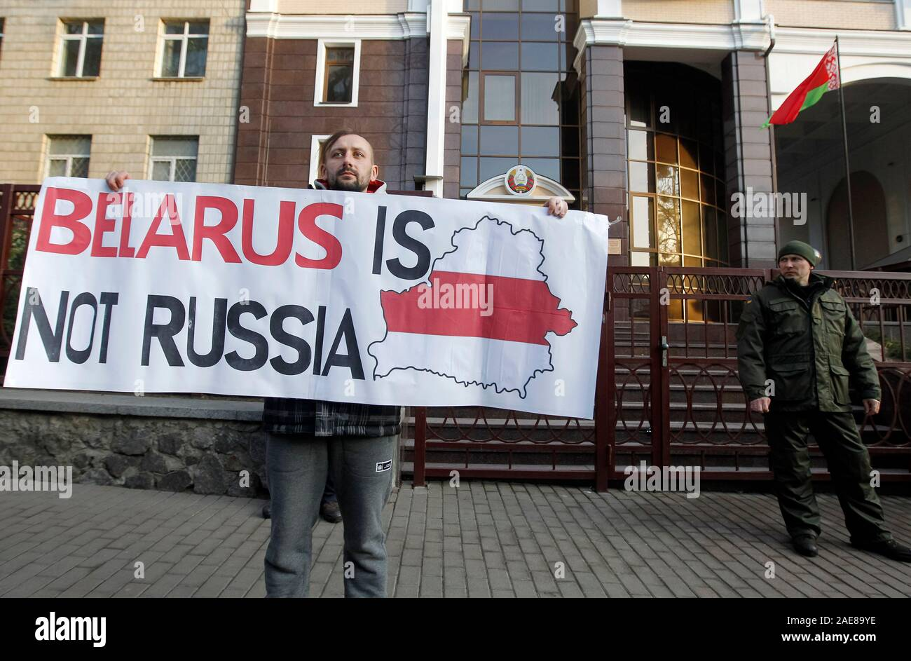 An activist holds a placard during a protest against the Belarus-Russia integration program, outside the Belarusian Embassy in Kiev.Protesters oppose the integration of Belarus and Russia and consider that sign a new agreement of deepening integration can lead to Belarus losing its independence. Presidents of Russia and Belarus, Vladimir Putin and Alexander Lukashenko meet and talk about road maps for the integration of the two countries taking place in Russia on December 7, 2019, reportedly by media. Stock Photo