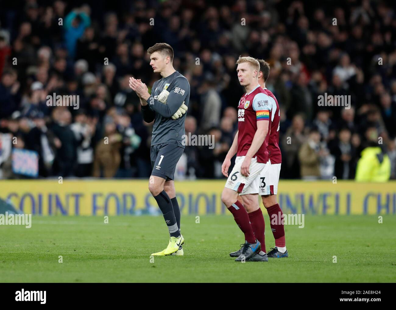Tottenham Hotspur Stadium, London, UK.  7th Dec, 2019. English Premier League Football, Tottenham Hotspur versus Burnley; Goalkeeper Nick Pope, Erik Pieters and Ben Mee of Burnley all disappointed while walking towards the Burnley fans after full time - Strictly Editorial Use Only. No use with unauthorized audio, video, data, fixture lists, club/league logos or 'live' services. Online in-match use limited to 120 images, no video emulation. No use in betting, games or single club/league/player publications Credit: Action Plus Sports/Alamy Live News Stock Photo