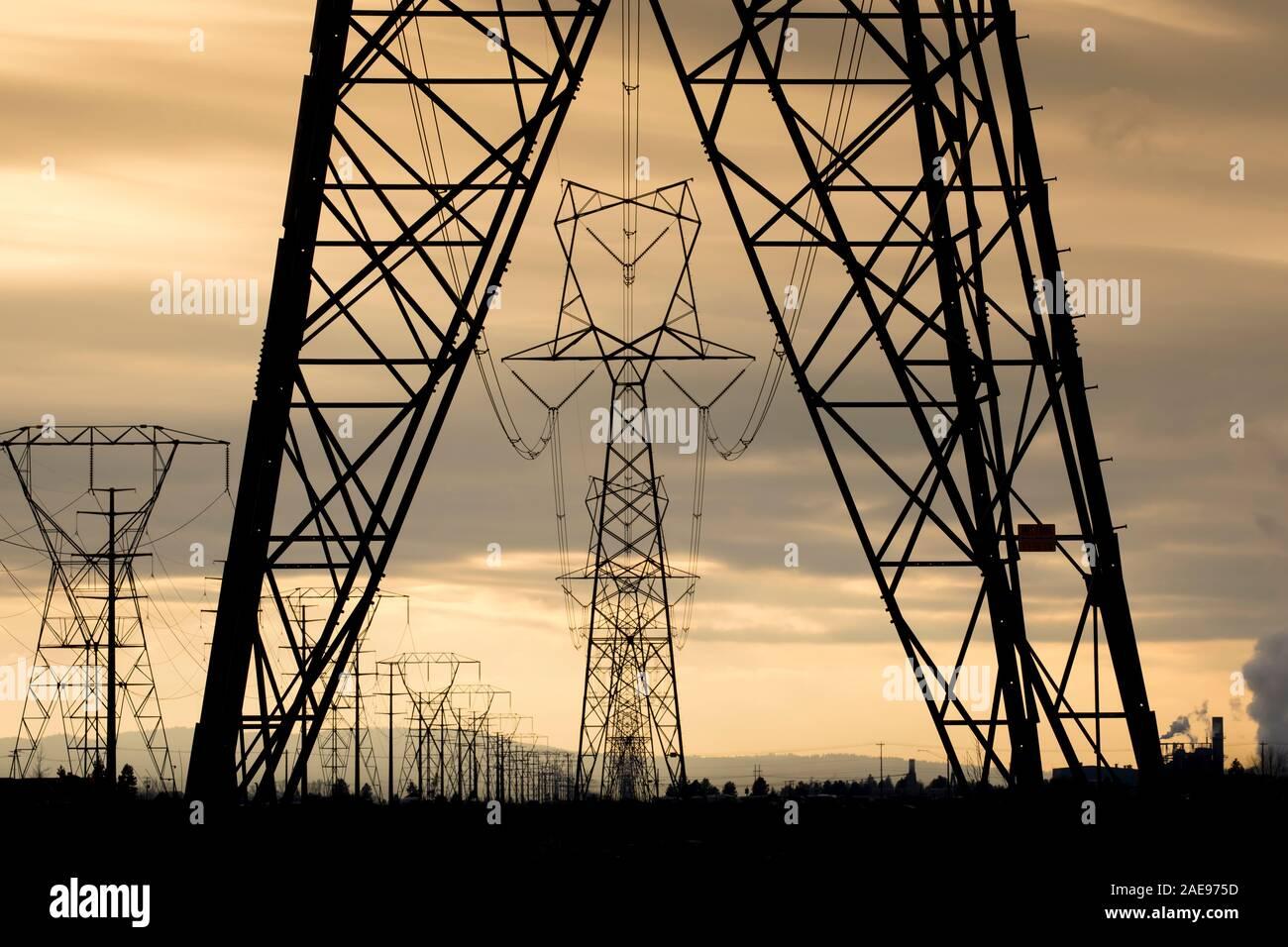 Eletrical towers and power lines close to sunset in north Idaho. Stock Photo