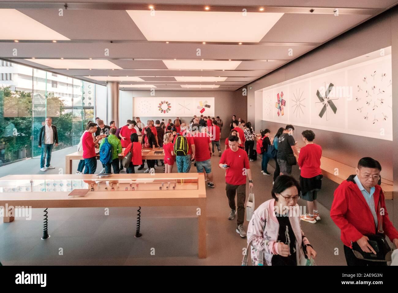 HongKong - November,  2019: Costumers nside the Apple Store in Hongkong at night Stock Photo