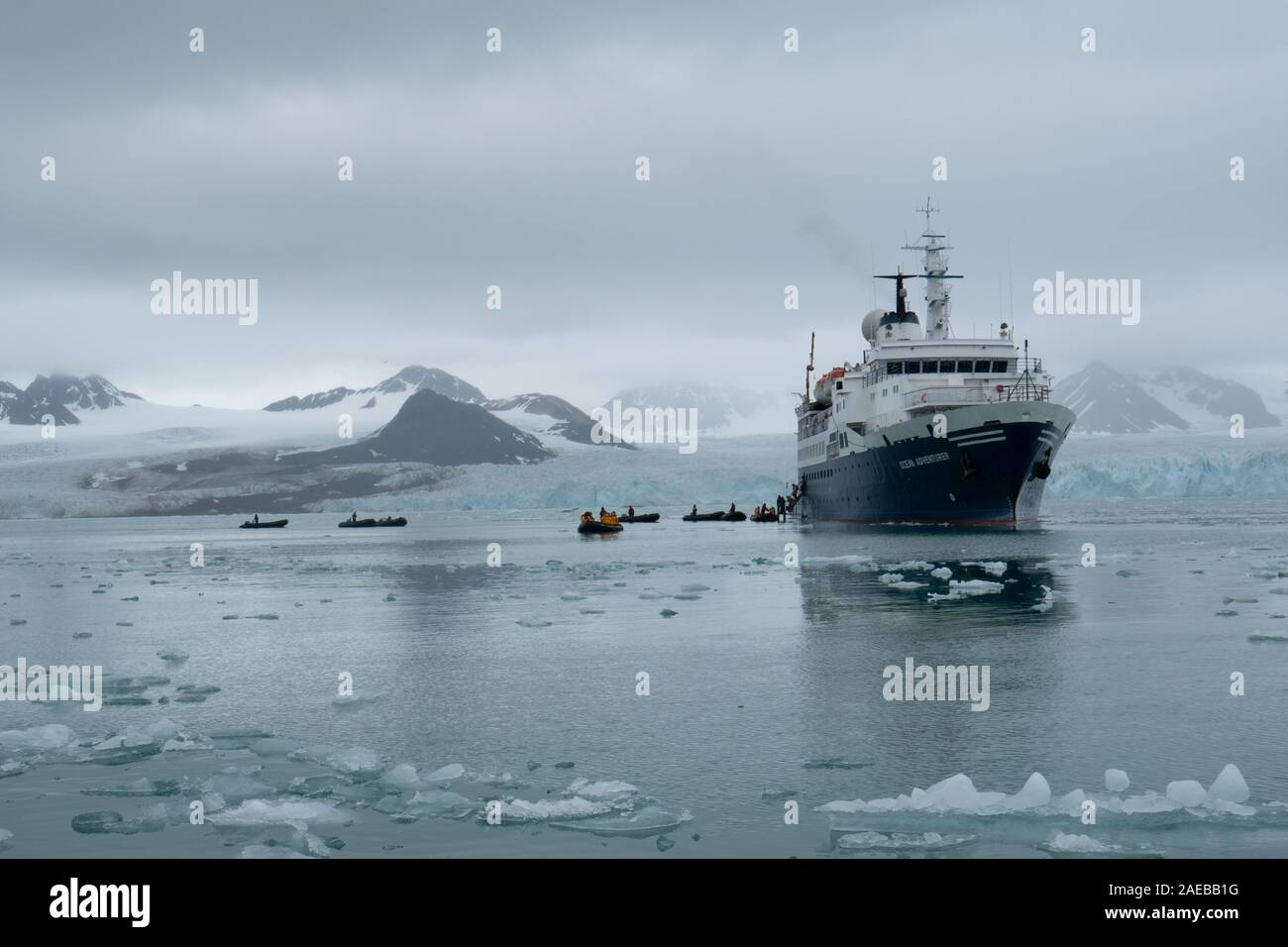 A cruise ship in the Arctic sea ice in Svalbard, Norway in July Stock Photo