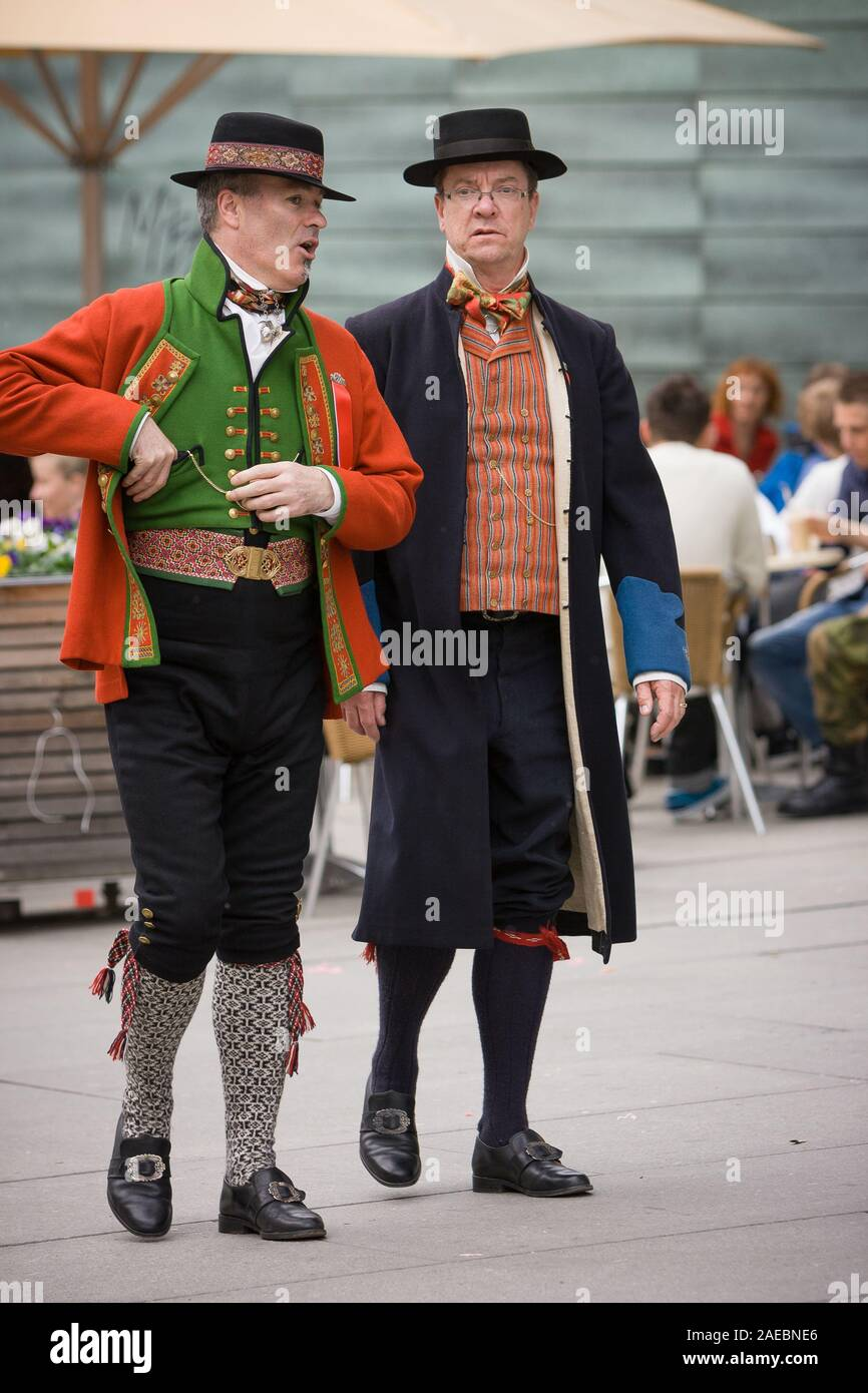 Oslo, Norway - May 17, 2010: National day in Norway. Norwegians at traditional celebration and parade on Karl Johans Gate street. Stock Photo