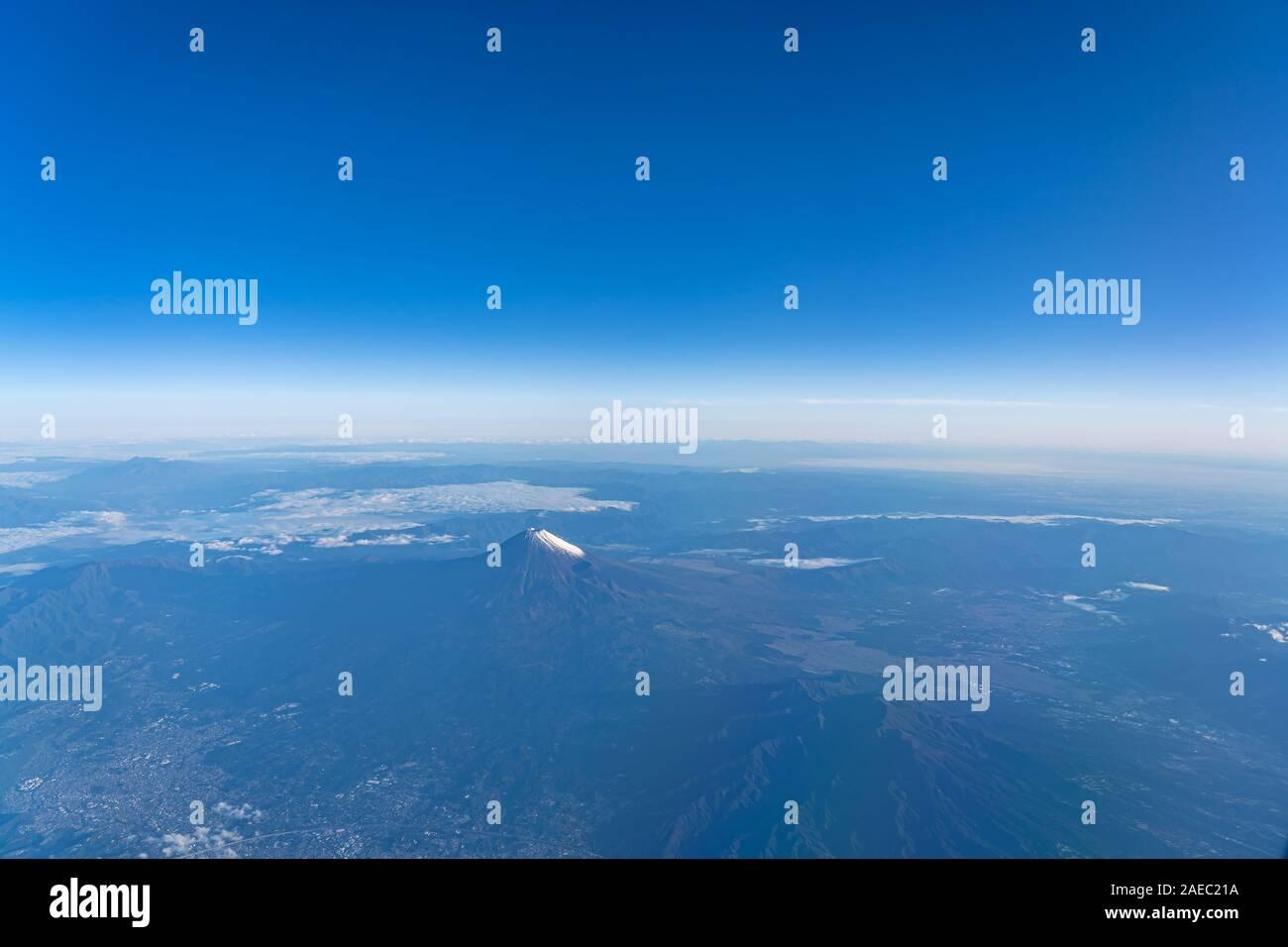 A bird's eye view close-up the Mount Fuji ( Mt. Fuji ) and blue sky. Scenery landscapes of the Fuji-Hakone-Izu National Park. Shizuoka Prefecture, Jap Stock Photo