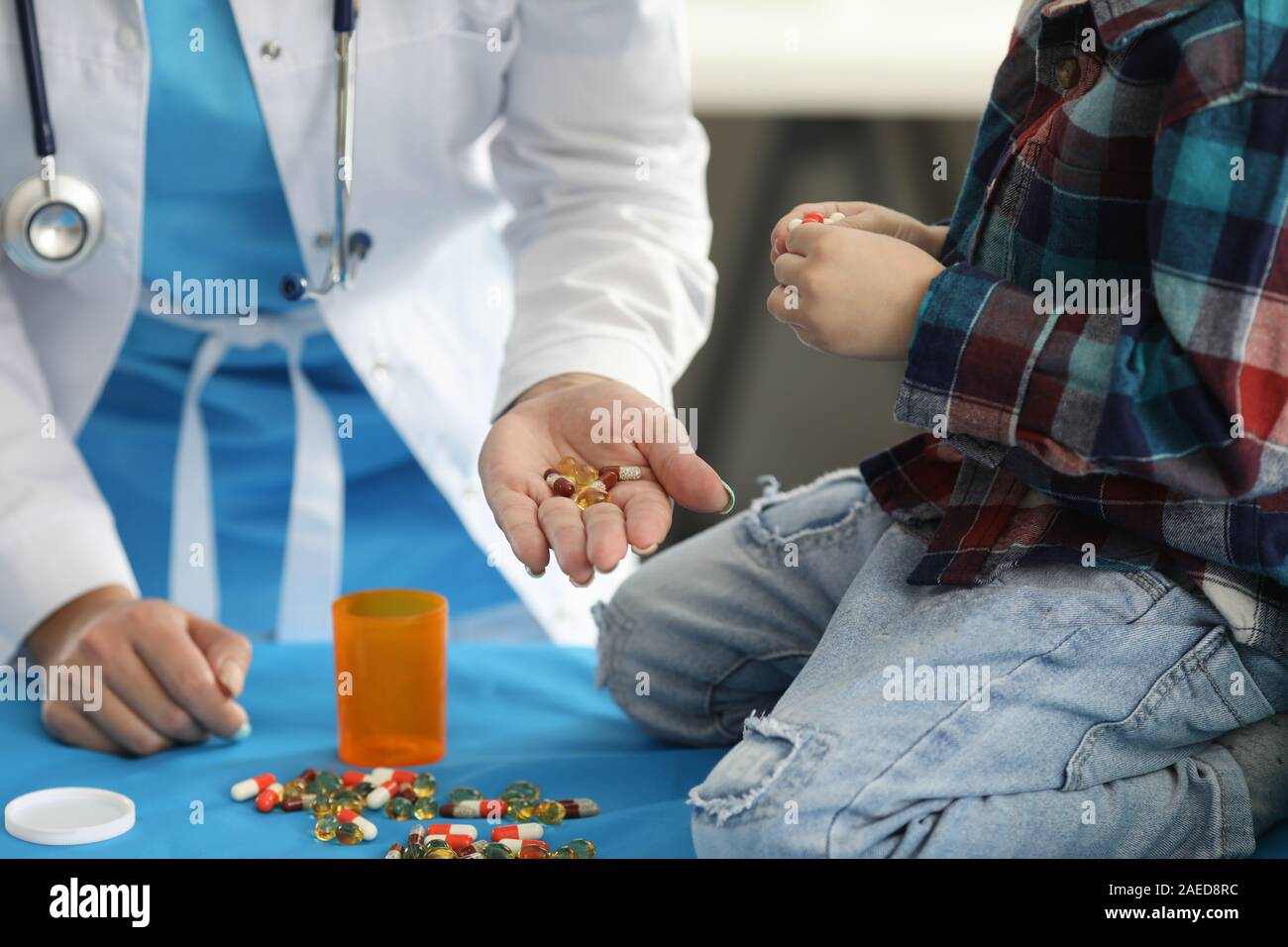 Spilled tablets on table Stock Photo