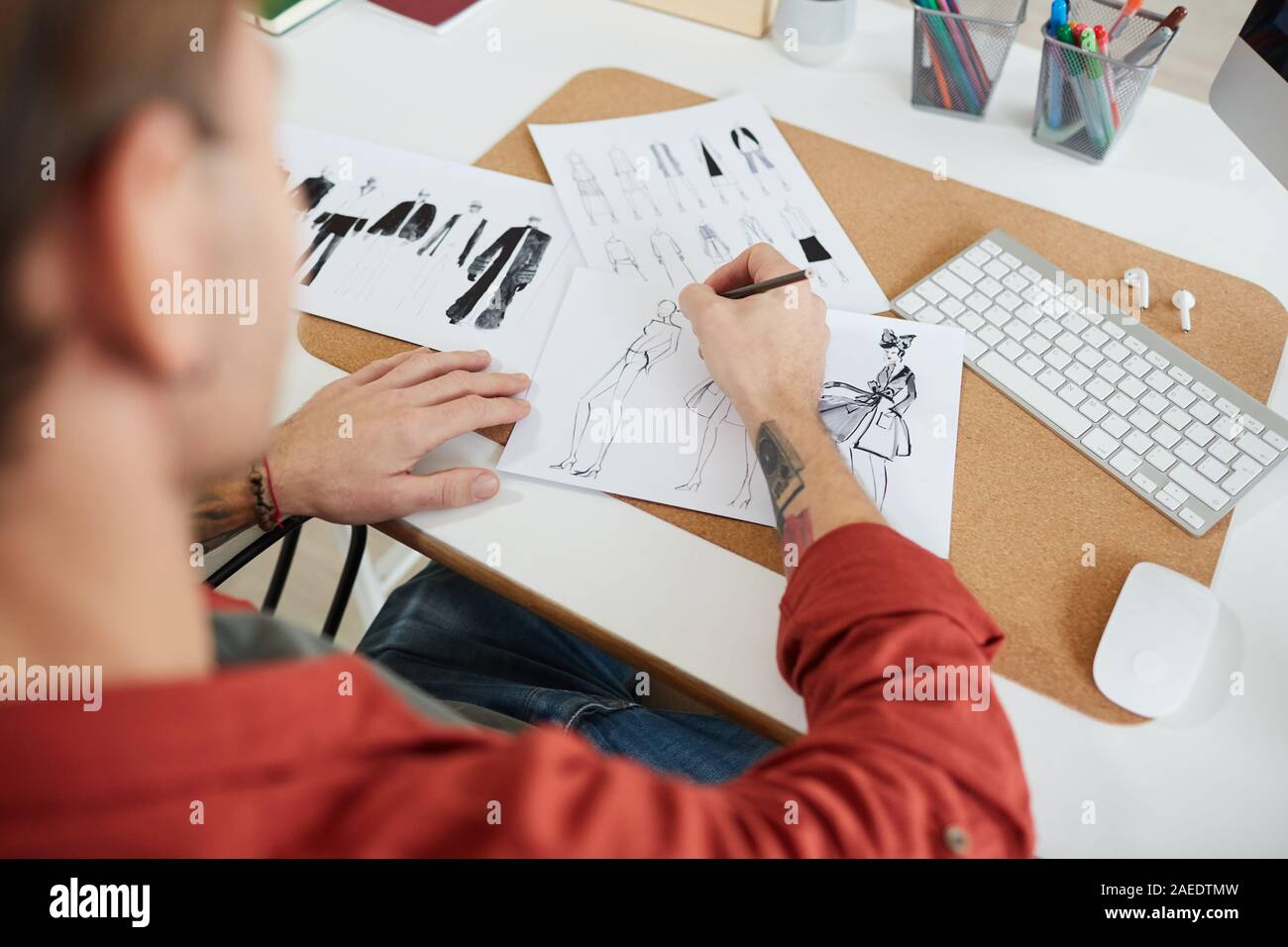 High Angle View At Tattooed Male Fashion Designer Drawing Sketches At Workplace In Studio Or Atelier Copy Space Stock Photo Alamy