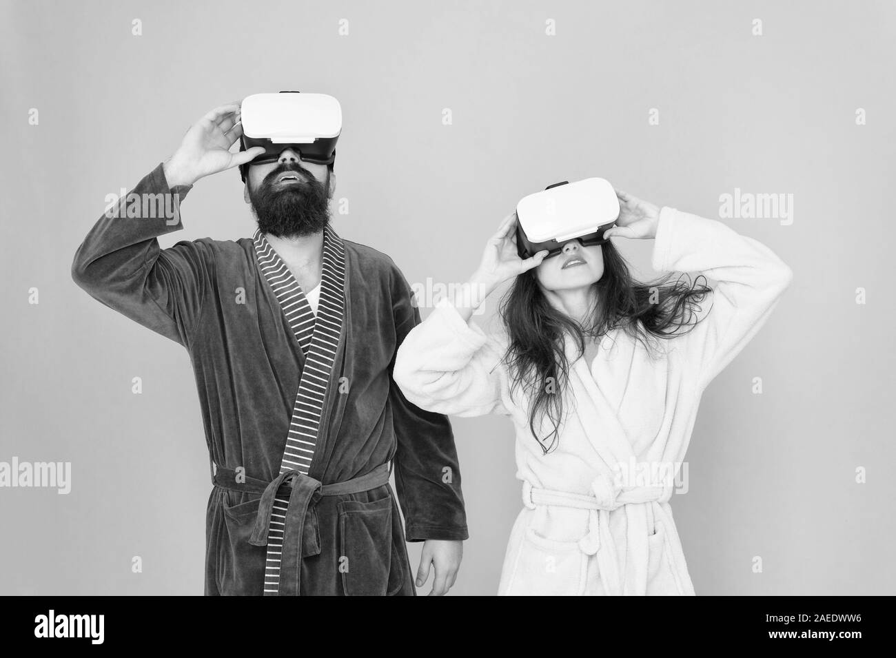 morning start with future technology. digital couple. innovation in family relations. create your reality. New world of virtual reality. family couple wear vr headset. girl and man relax in bathrobe. Stock Photo