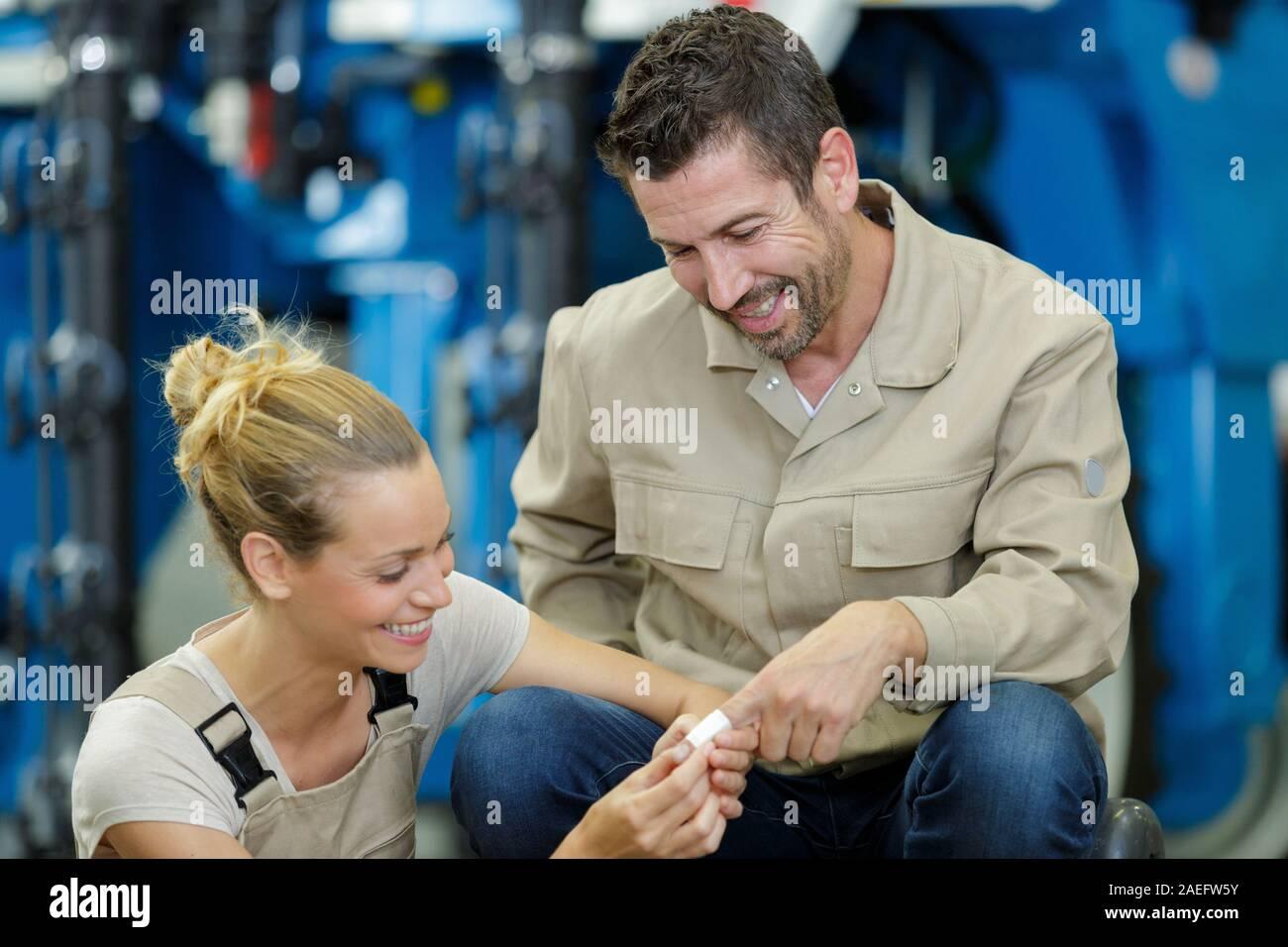 woman helping an injured man Stock Photo