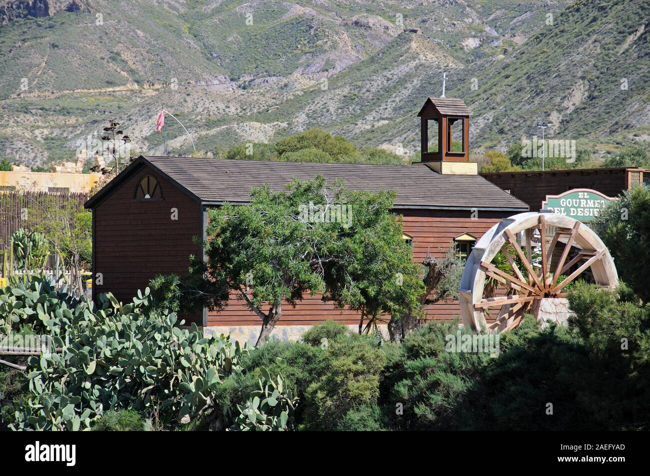 Wooden church building in Fort Apache at Mini Hollywood with mountains to the rear, Tabernas, Almeria Province, Andalucia, Spain. Stock Photo