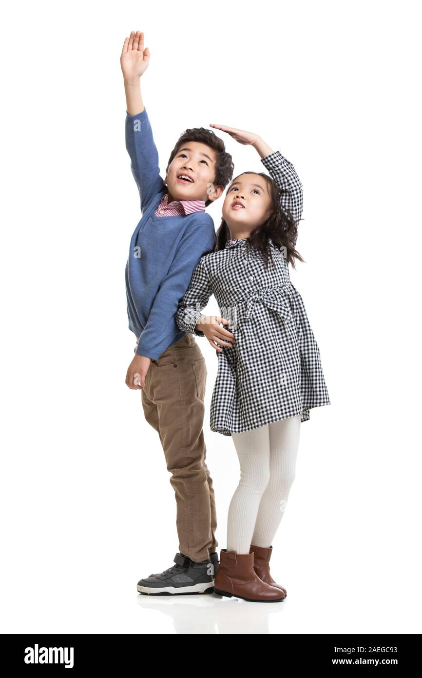 Two children measuring height Stock Photo
