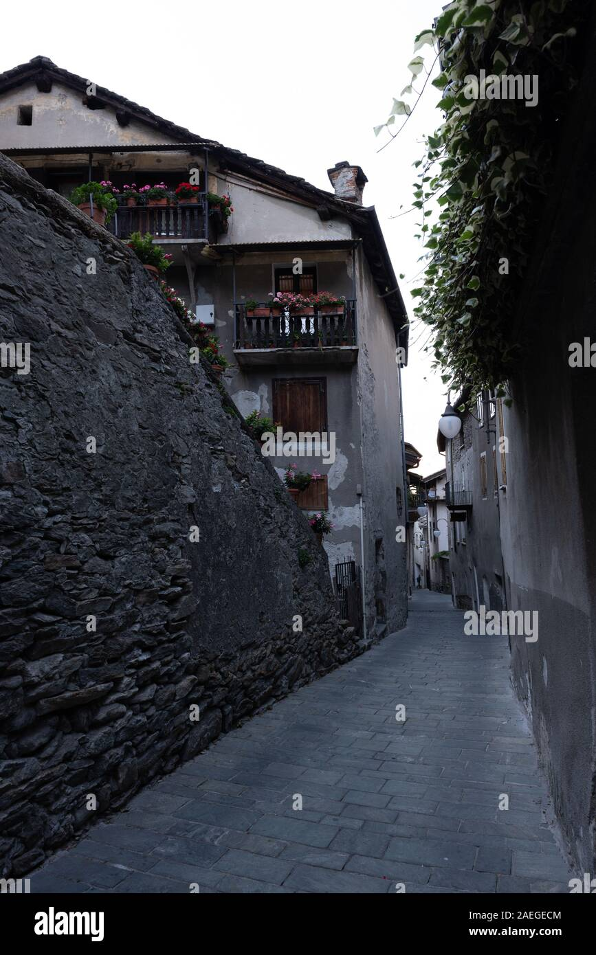 Alley in the mountain village in Bard, vertical image Stock Photo