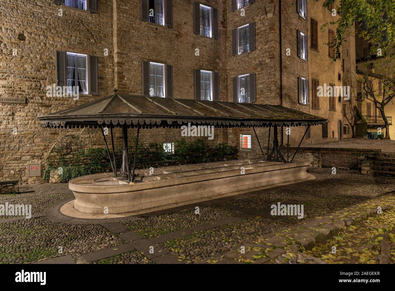 Ancient public wash-house in via Lupo in Bergamo Alta, horizontal night image in the Upper Town Stock Photo