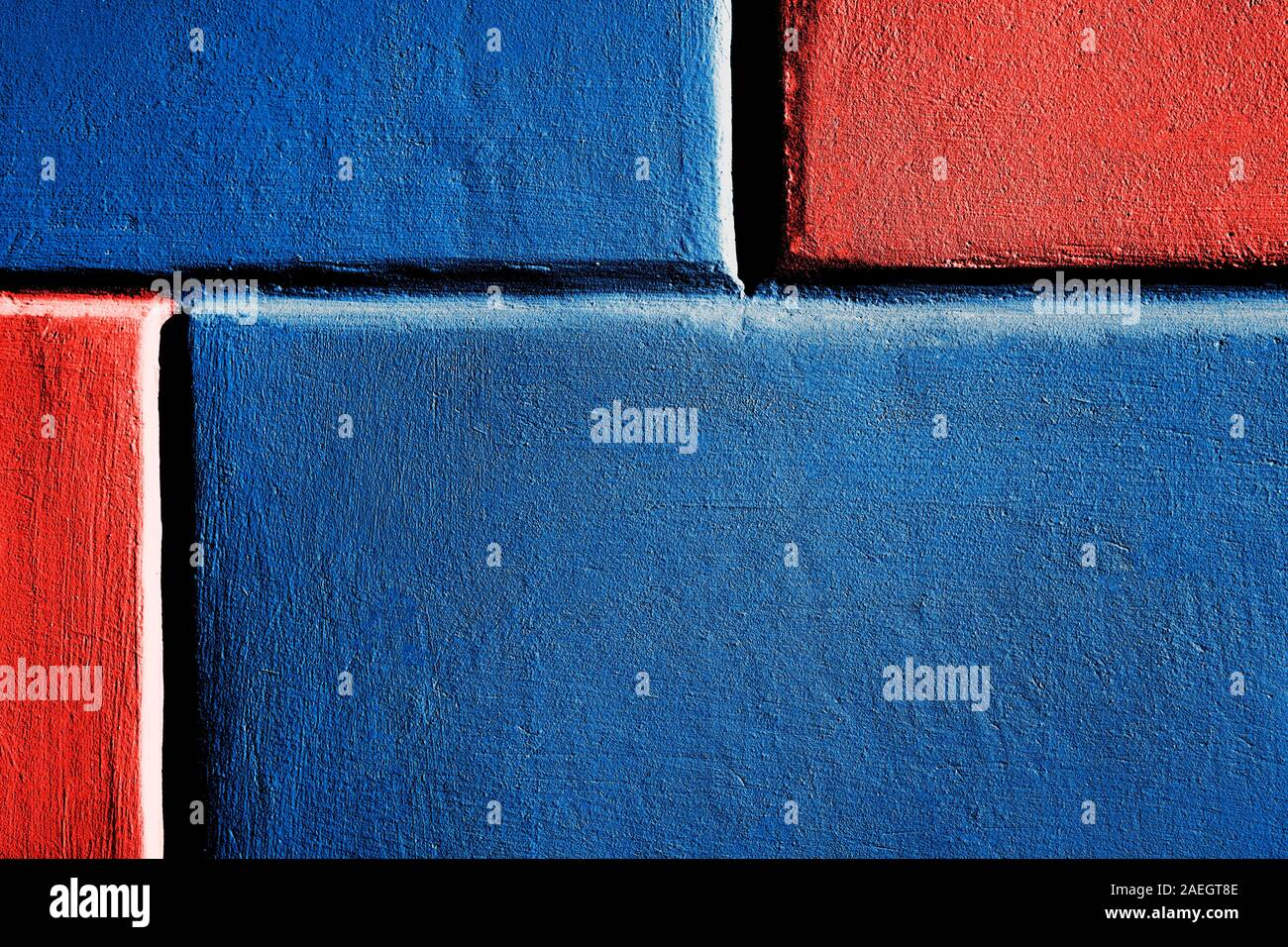 Close up image of blue brick wall with coral color parts. Background. Trendy colors of 2019 and 2020. Stock Photo