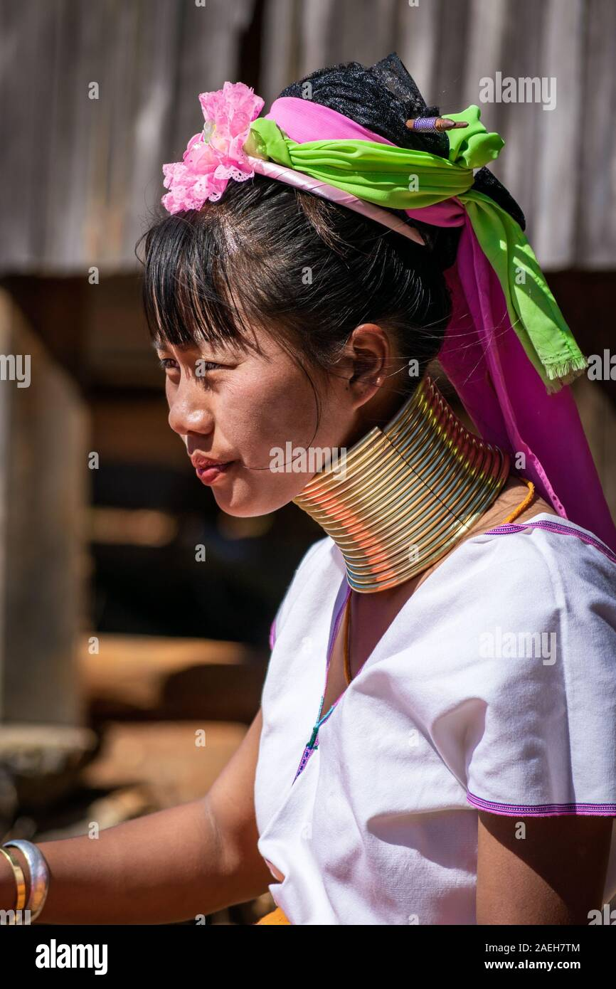 Portrait of a young woman from Kayan tribe wearing traditional outfit (and a modern watch) and brass necklace. Pan Pet, Loikaw, Myanmar. Stock Photo