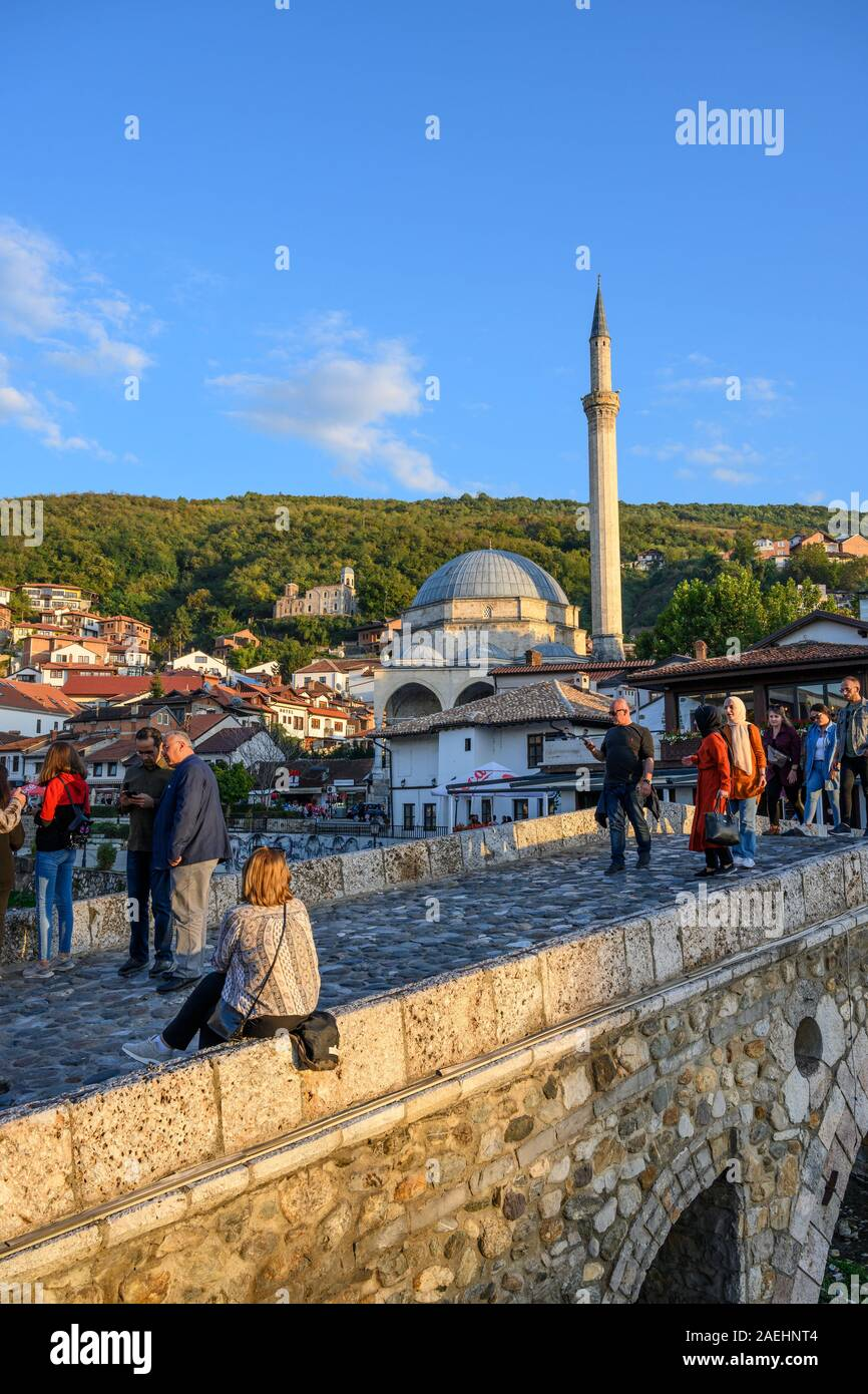 Looking across to The old town of Prizren and The Sinan Pasha Mosque from the stone bridge across the Bistrica river. in Kosovo, central Balkans. Stock Photo