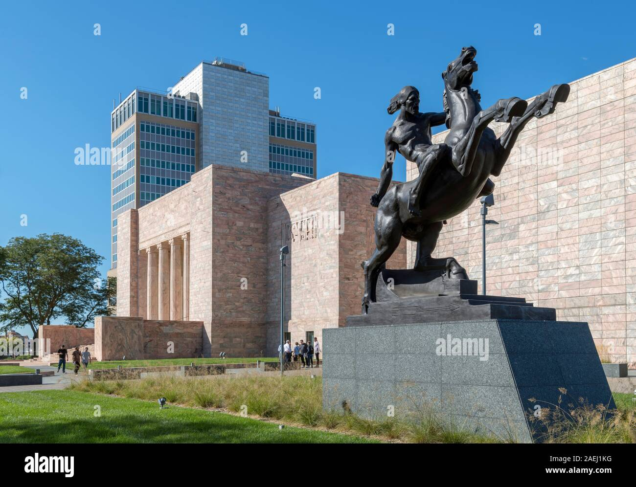 "Joslyn Art Museum, Omaha, Nebraska, USA.. The statue in the foreground is ""Sioux Warrior"" by Matthew Placzek. Stock Photo"