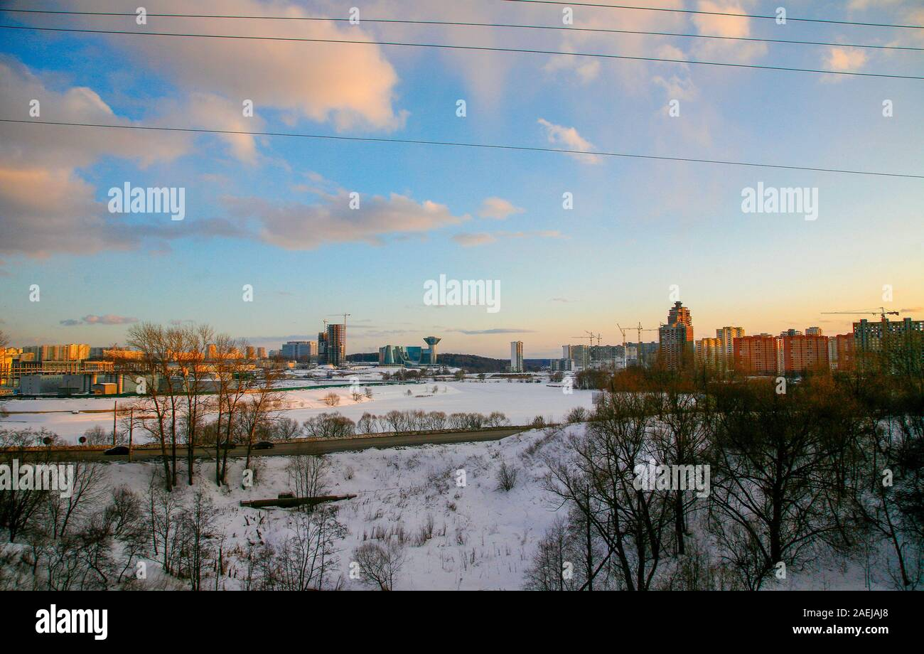 Sunset at Krasnogorsk and building of government of Moscow oblast (region). Moscow-river is ice bound . Majestic landscape and cloudscape ! Stock Photo