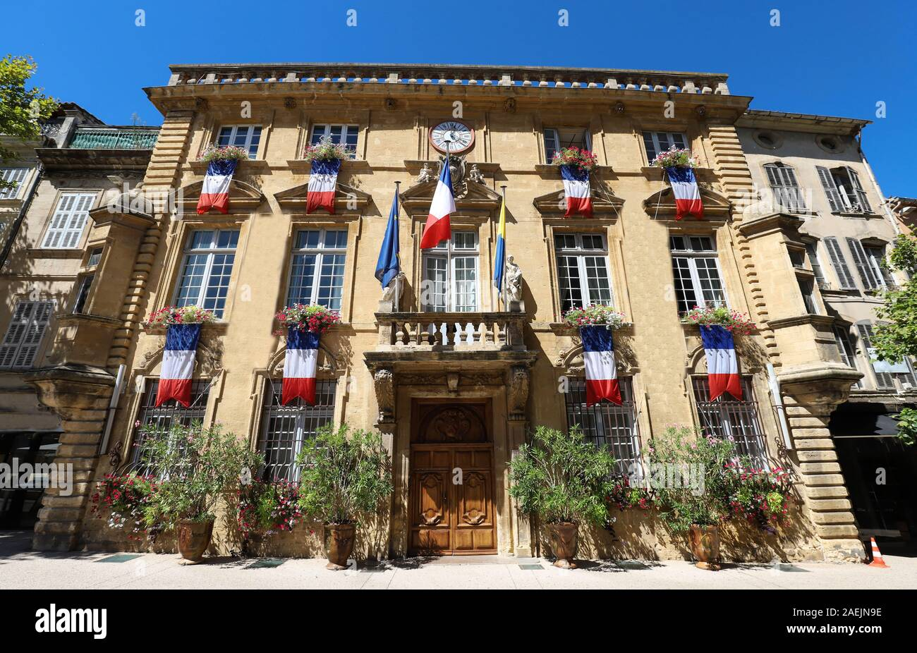 The town hall of Salon-en-Provence decorated with national flags , South of France . Stock Photo