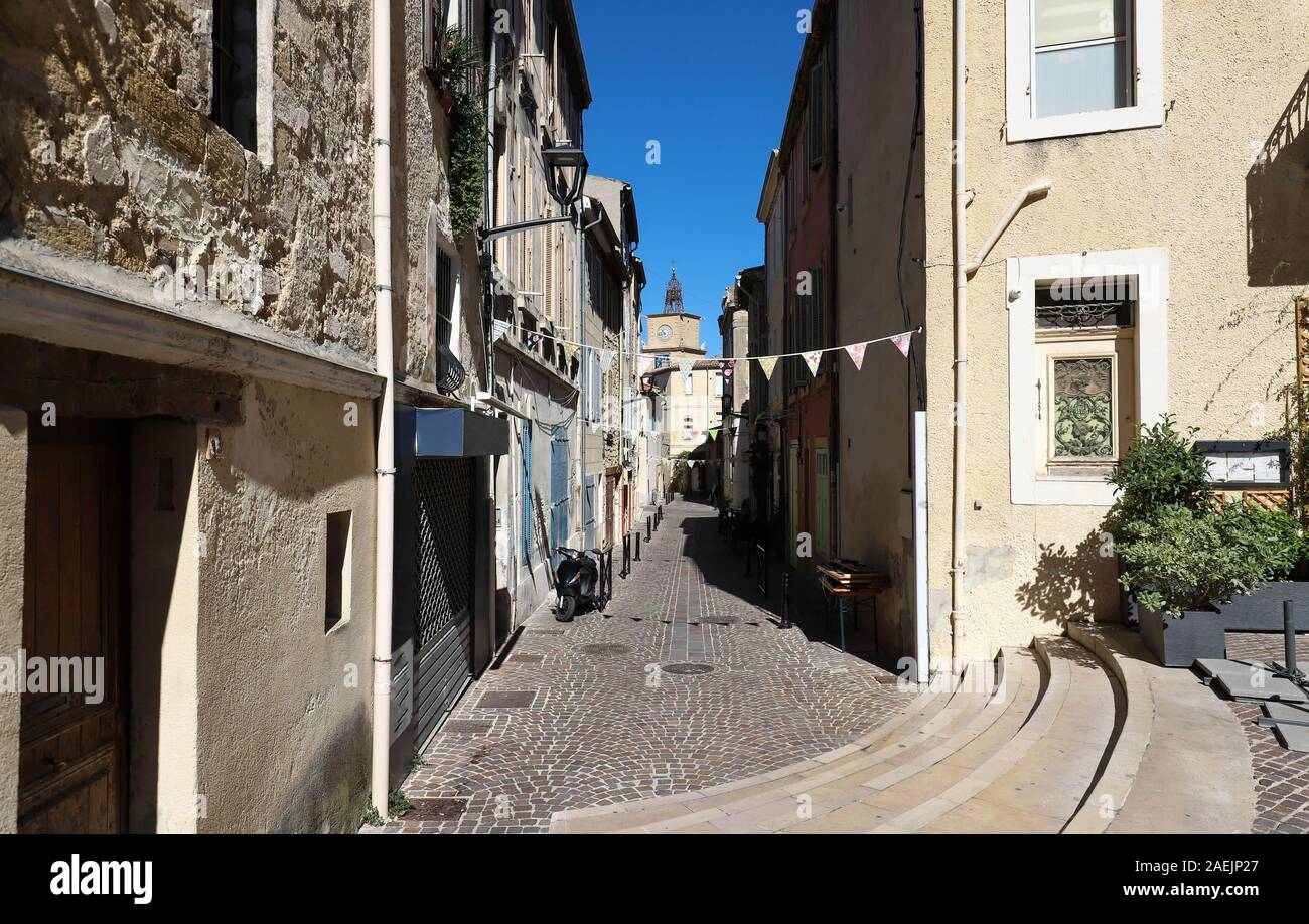 The typical alley in an old town in the South of France. Stock Photo