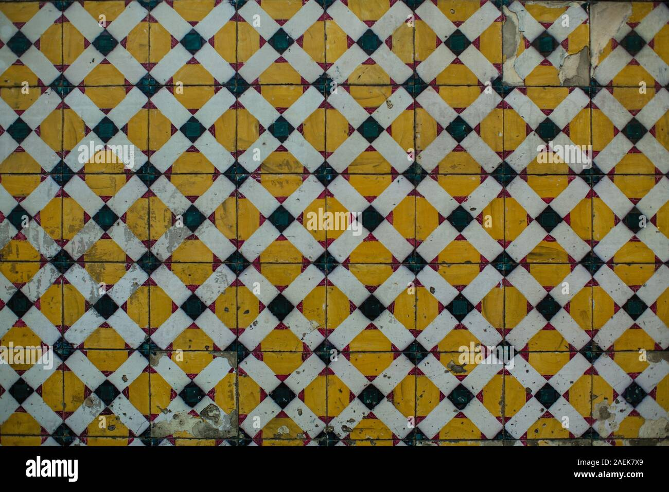 Azulejos ceramic tilework, traditional old tiles wall on the Portuguese street. Stock Photo