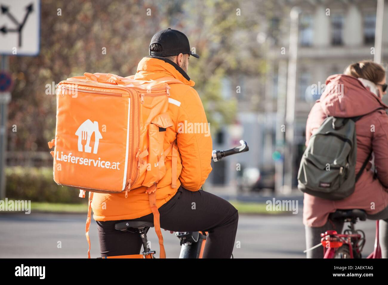 VIENNA, AUSTRIA - NOVEMBER 6, 2019: Lieferservice logo on a delivery guy in Vienna. Also called Lieferando, it is a subsidiary of Takeaway.com, a Dutc Stock Photo